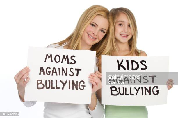moms and kids against bullying - anti bullying symbols stock pictures, royalty-free photos & images