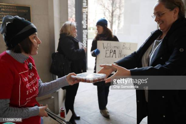 Moms Clean Air Force activist Liz Brandt welcomes Environmental Protection Agency employees back to work with cinnamon rolls outside the Federal...