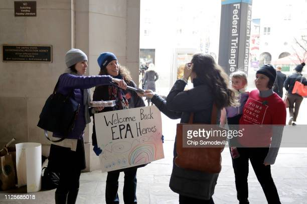 Moms Clean Air Force activists Martha Roberts Molly Rauch and Liz Brandt holding her daughter Natalia Bednar welcome Environmental Protection Agency...