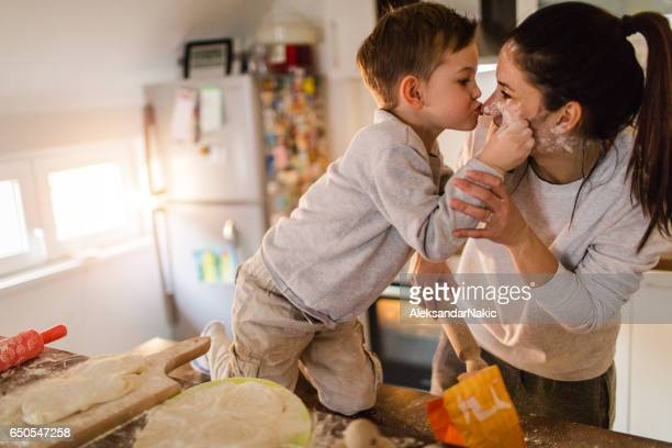 mom's little baker - mother and son stock photos and pictures