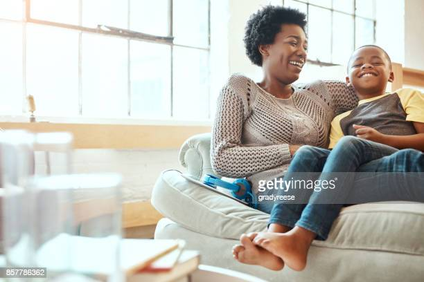 mom's number one guy - african american family home stock photos and pictures