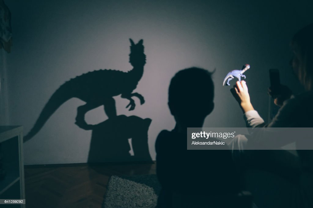 Mom's shadow puppet show : Stock Photo
