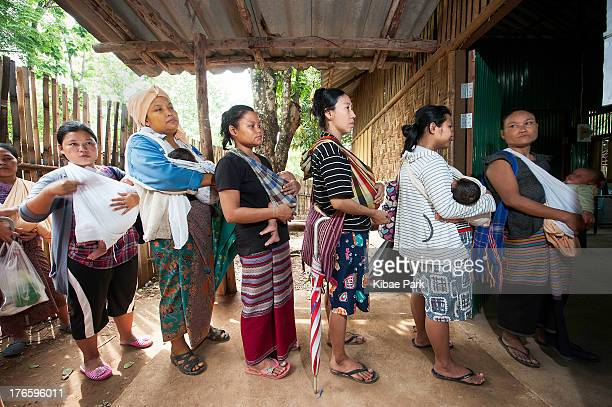 CONTENT] Moms wait for their turn to register their new born babies at the Birth Registration Office of UNHCR inside the Mae La refugee camp in Mae...