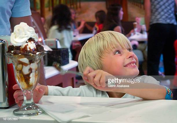 MOMSam Krason <cq> beams up at his mother Terry <cq> before digging into his cookie dough ice cream sundae with hot fudge caramel whip cream and...