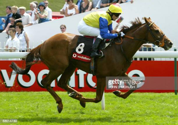 Momtic, owned by Heath, Keenan and Verrier, and ridden by K. Fallon, wins the Vodafone Mile at the Epsom Downs Derby on Ladies Day, 03 June, 2005. It...