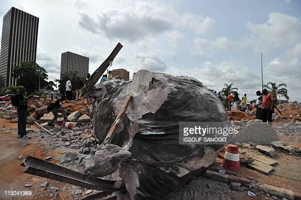 A momument in the shape of an elephant one of many symbolising the regime of expresident Laurent Gbagbo is demolished on April 27 2011 by the new...