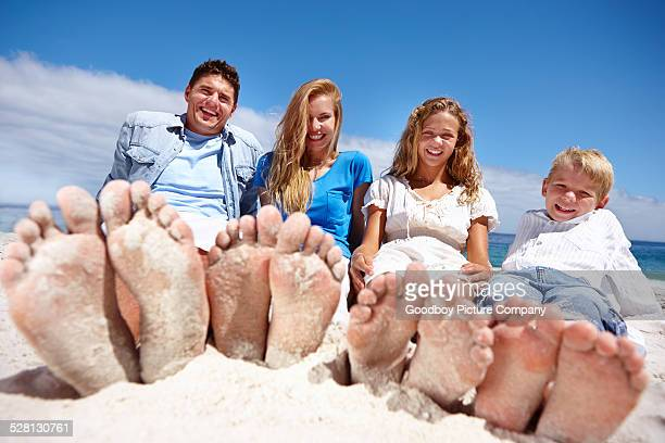 c'mon, get some sand between your toes - beautiful male feet stock photos and pictures