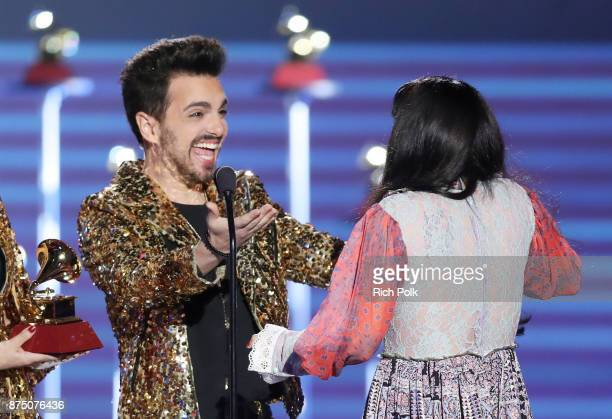 Mon Laferte accepts Best Alternative Song for 'Amarrame' from Alejandro Sergi onstage at the Premiere Ceremony during the 18th Annual Latin Grammy...