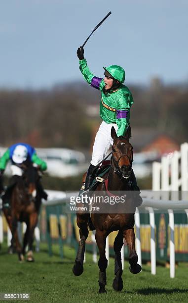 Mon Mome ridden by Liam Treadwell celebrates winning the John Smith's Grand National Steeple Chase Handicap at Aintree on April 4 2009 in Liverpool...