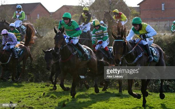 Mon Mome ridden by Liam Treadwell clears Becher's Brook alongside Idle Talk ridden by Brian Harding on the way to victory in the John Smith's Grand...