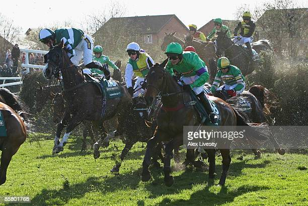 Mon Mome ridden by Liam Treadwell clears Becher's Brook as Nick Scholfield attempts to hang on to Cornish Sett on their way to victory in the John...