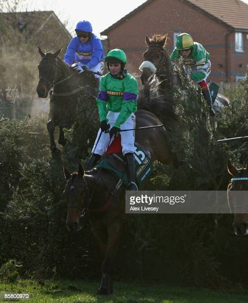 Mon Mome ridden by Liam Treadwell clears Becher's Brook on the way to victory in the John Smith's Grand National Steeple Chase at Aintree Racecourse...