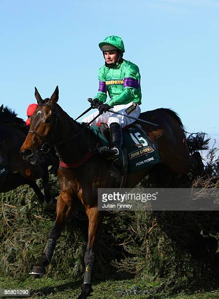 Mon Mome ridden by Liam Treadwell jumps the last and goes on to land The John Smiths Grand National Steeple Chase during day three of the John...