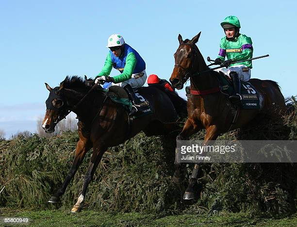 Mon Mome ridden by Liam Treadwell jumps the last with Comply of Die ridden by Timmy Murphy in The John Smiths Grand National Steeple Chase during day...