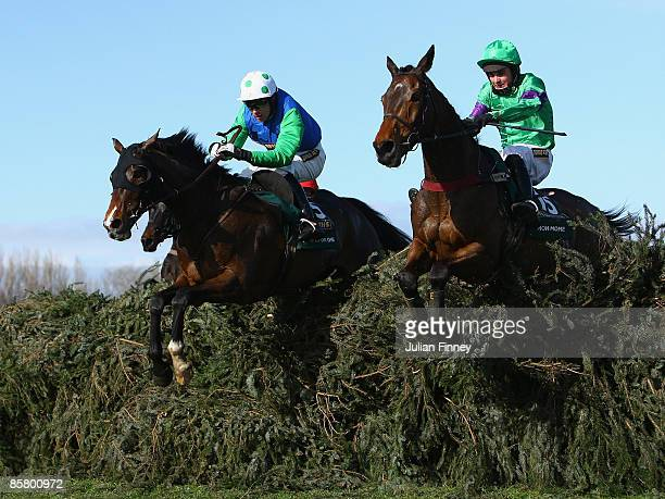 Mon Mome ridden by Liam Treadwell jumps the last with Comply of Die ridden by Timmy Murphy in The John Smiths Grand National Steeple Chaseduring day...