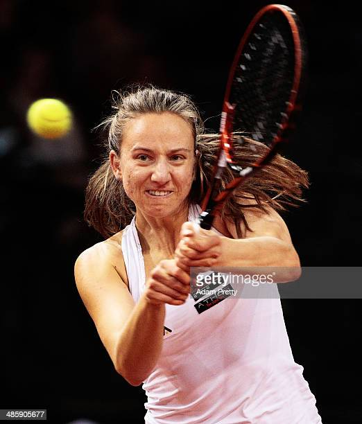 Mona Barthel of Germany hits a backhand during her first round match against Ajla Tomljanovic of Croatia on day one of the Porsche Tennis Grand Prix...
