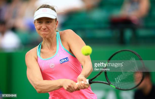 Mona Barthel of Germany hits a backhand during her second round match against Magdalena Rybarikova of Slovakia on Day Five of the Nature Valley Open...