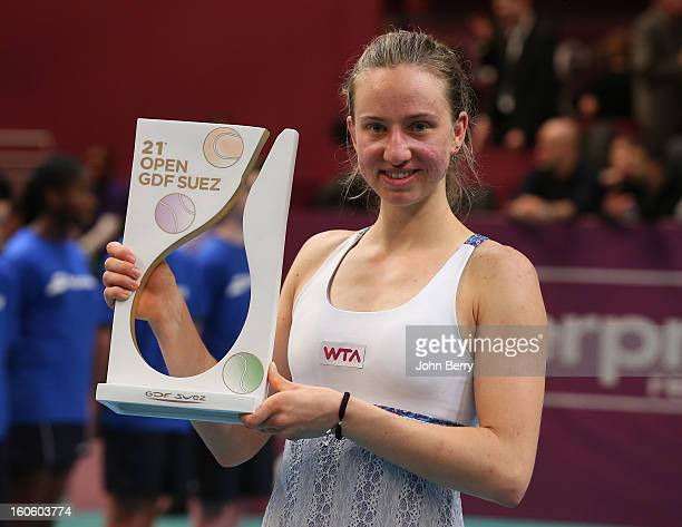 Mona Barthel of Germany holds the trophy after her victory over Sara Errani of Italy in the final of the Open GDG Suez 2013 at the Stade Pierre de...