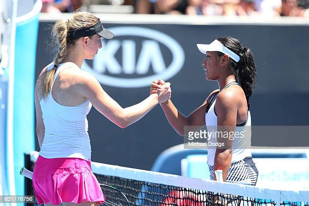 Mona Barthel of Germany is congratulated by Destanee Aiava of Australia after their first round match on day one of the 2017 Australian Open at...