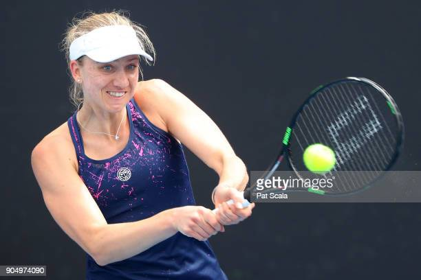 Mona Barthel of Germany plays a backhand in her first round match against Monica Niculescu of Romania on day one of the 2018 Australian Open at...