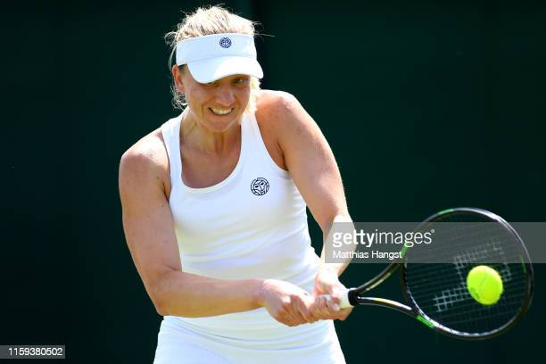 Mona Barthel of Germany plays a backhand in her Ladies' Singles first round match against Marie Bouzkova of Czech Republic during Day one of The...