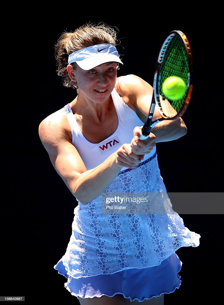 Mona Barthel of Germany plays a backhand in her second round match against Grace Min of the USA servesduring day two of the 2013 ASB Classic on January 1, 2013 in Auckland, New Zealand.