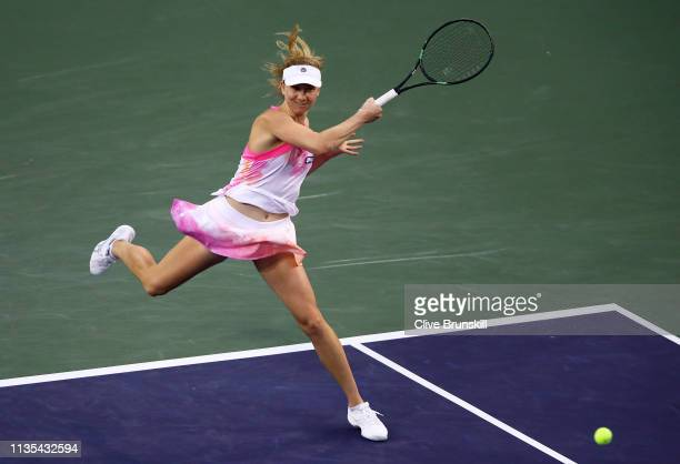 Mona Barthel of Germany plays a forehand against Venus Williams of the United States during their women's singles fourth round match on day nine of...