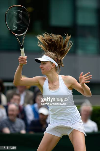 Mona Barthel of Germany plays a forehand during the Ladies' Singles second round match against Madison Keys of United States of America on day four...