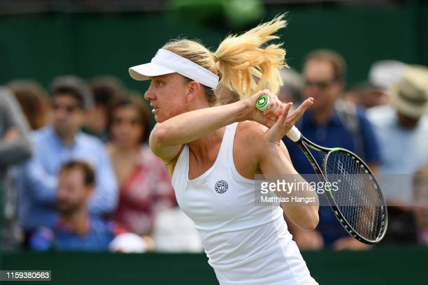 Mona Barthel of Germany plays a forehand in her Ladies' Singles first round match against Marie Bouzkova of Czech Republic during Day one of The...