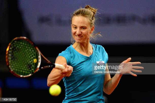 Mona Barthel of Germany plays a forehand in her match against Marion Bartoli of France during day four of the WTA Porsche Tennis Grand Prix at...