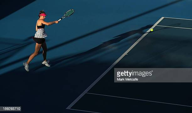 Mona Barthel of Germany plays a forehand in her semi final match against Kirsten Flipkens of Belgium during day eight of the Hobart International at...