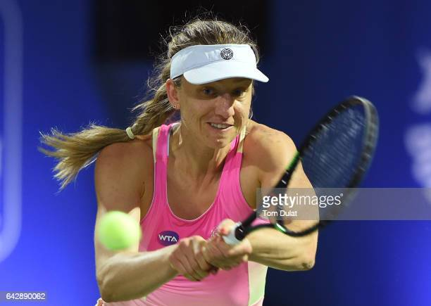 Mona Barthel of Germany plays backhand against Jelena Jankovic of Serbia during day one of the WTA Dubai Duty Free Tennis Championship at the Dubai...