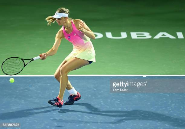 Mona Barthel of Germany plays forehand against Jelena Jankovic of Serbia during day one of the WTA Dubai Duty Free Tennis Championship at the Dubai...