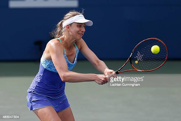 Mona Barthel of Germany plays in her doubles match with Sabine Lisicki of Germany against Raquel KopsJones and Maria Sanchez of the United States...