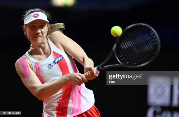 Mona Barthel of Germany returns a backhand during the match on day 4 of the Porsche Tennis Grand Prix between Laura Siegemund of Germany and Mona...