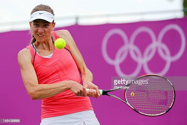 Mona Barthel of Germany returns a shot against Urszula Radwanska of Poland during their Women's Singles Tennis match on Day 1 of the London 2012...