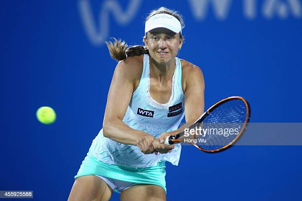 Mona Barthel of Germany returns a shot during her match against Shuai Peng of China during day two of the 2014 Dongfeng Motor Wuhan Open at Wuhan...