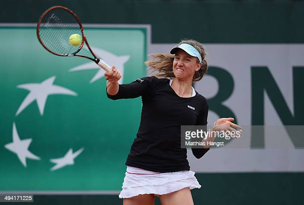 Mona Barthel of Germany returns a shot during her women's singles match against Sabine Lisicki of Germany on day four of the French Open at Roland...