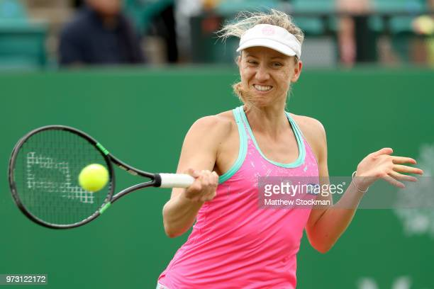 Mona Barthel of Germany returns a shot to Magdelena Rybarikova of Slovakia during Day five of the Nature Valley Open at Nottingham Tennis Centre on...