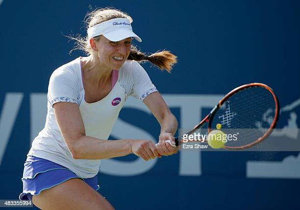 Mona Barthel of Germany returns a shot to Varvara Lepchenko of the United States during Day 5 of the Bank of the West Classic at Stanford University...