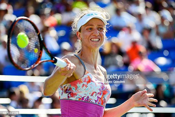 Mona Barthel of Germany returns a shot to Varvara Lepchenko of the United States in their Women's Singles Third Round match on Day Six of the 2015 US...