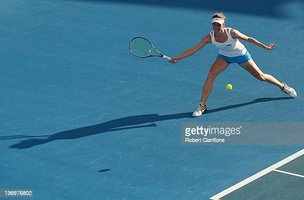 Mona Barthel of Germany returns a shot to Yanina Wickmayer of Belgium during the singles final match during day seven of the 2012 Hobart...