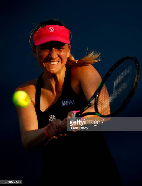 Mona Barthel of Germany returns the ball during her women's singles first round match against Marketa Vondrousova of Czech Republic on Day Two of the...