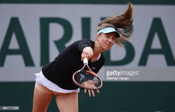 Mona Barthel of Germany serves during her women's singles match against Sabine Lisicki of Germany on day four of the French Open at Roland Garros on...