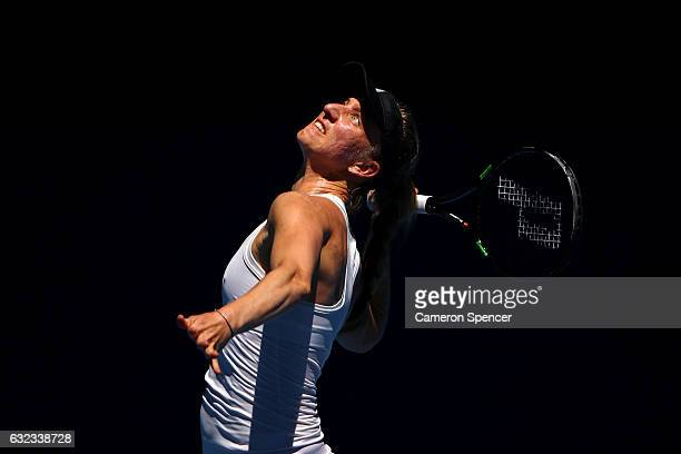 Mona Barthel of Germany serves in her fourth round match against Venus Williams of the United States on day seven of the 2017 Australian Open at...