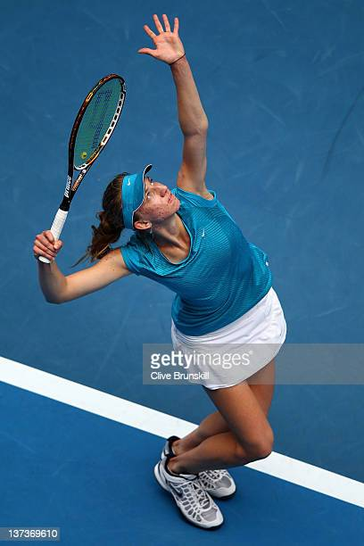 Mona Barthel of Germany serves in her third round match against Victoria Azarenka of Belarus during day five of the 2012 Australian Open at Melbourne...