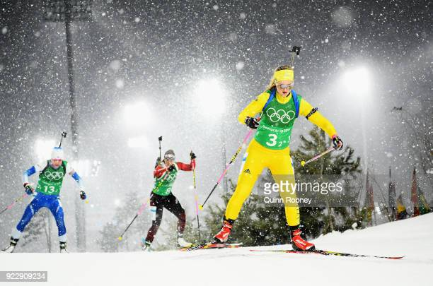 Mona Brorsson of Sweden Lena Haecki of Switzerland and Kaisa Makarainen of Finland compete during the Women's 4x6km Relay on day 13 of the...