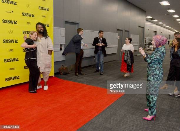 Mona Haydar takes a photo of Katie Couric at Katie Couric podcast LIVE The Muslim Next Door during SXSW at Austin Convention Center on March 11 2018...