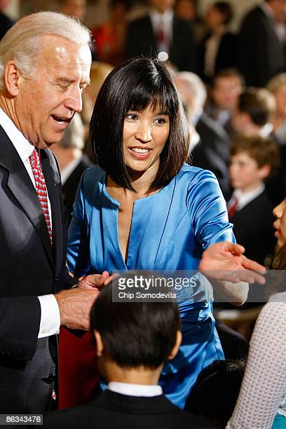 Mona Lee wife of US Commerce Secretary Gary Locke visits with Vice President Joe Biden after the commerce secretary and Health and Human Services...