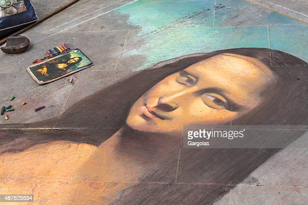 mona lisa unfinished in florence, italy - street artist stock photos and pictures